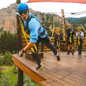 A zipliner posed to fly at Yellowstone Zipline Adventures