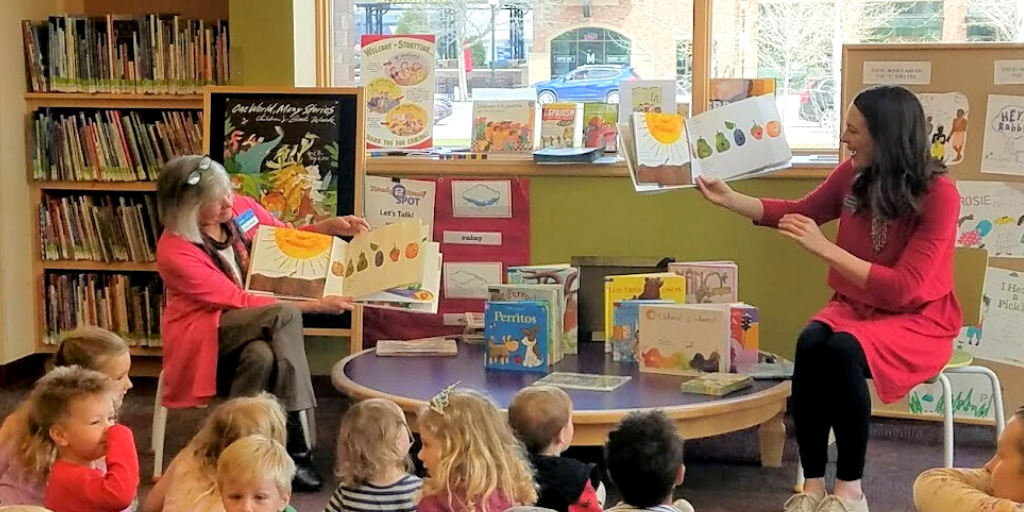 LIbrarians read a book to children at the Bozeman Library.